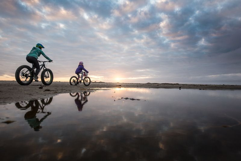 People riding bikes on coast