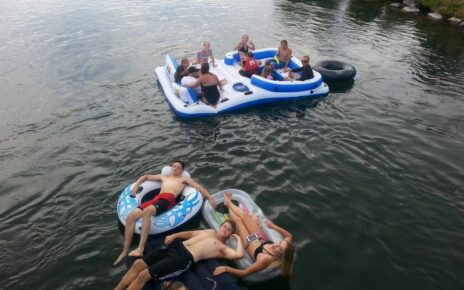 Family floating on river