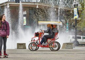 People on bicycle near fountain